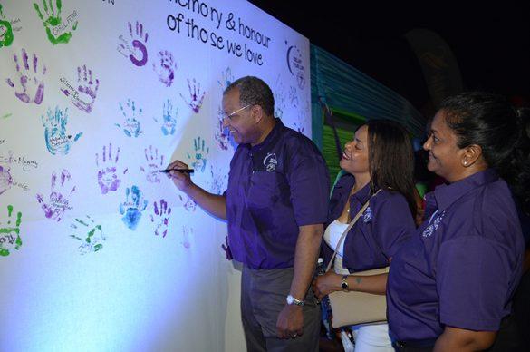r. Brawley signs the memory board