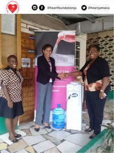 Mrs. Yvette Samuels Brown receiving water cooler